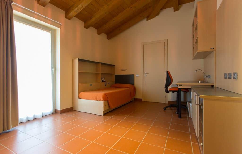 Camera da letto Residenze Piacenza